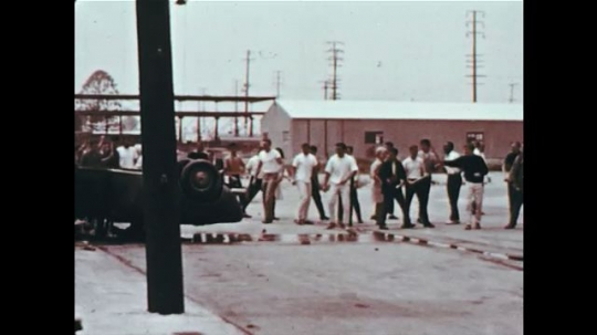 UNITED STATES 1960s: Police officers arrive at the scene of a riot.