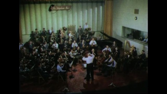 UNITED STATES 1950s: High angle shot of orchestra playing.