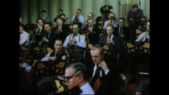 UNITED STATES 1950s: Musicians in orchestra playing / High angle shot of orchestra.