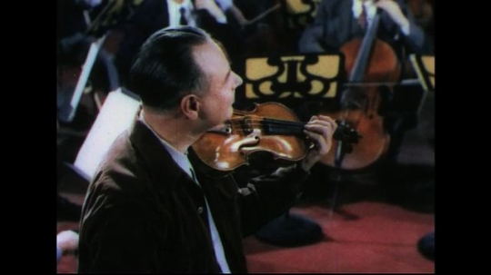 UNITED STATES 1950s: Slow zoom in on man playing violin.