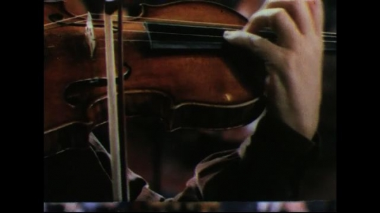 UNITED STATES 1950s: Close up of man playing violin.