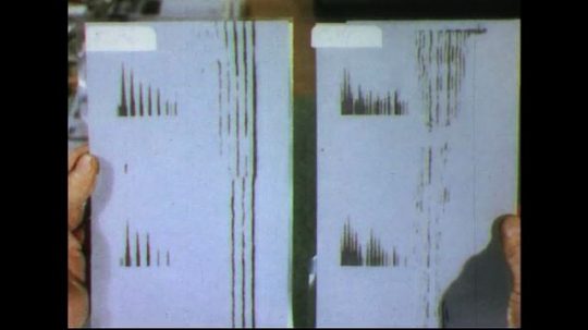 UNITED STATES 1950s: Two sheets of sound waves compared / Close up of Flute sound wave, close up of cello sound wave.