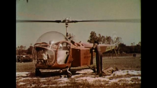 UNITED STATES 1950s: Mail is transported using a helicopter.
