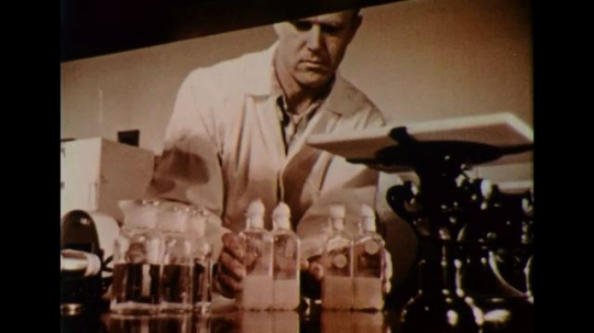 UNITED STATES 1950s: A scientist prepares vials of samples for study.