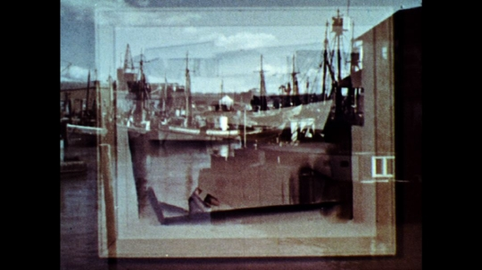 UNITED STATES: 1960s: framed artwork of boats in habour