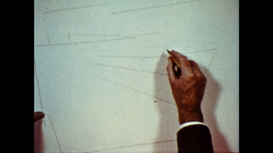 UNITED STATES: 1960s: hand draws landscape on paper.