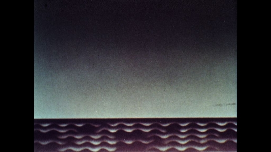 UNITED STATES: 1960s: wavy lines on bottom of paper. Light and dark animation.