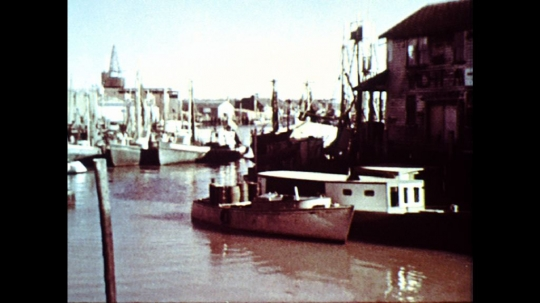 UNITED STATES: 1960s: boats in harbour. Painting of boats in harbour