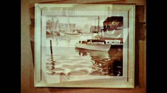 UNITED STATES: 1960s: painting of boats in harbour hangs on wall.