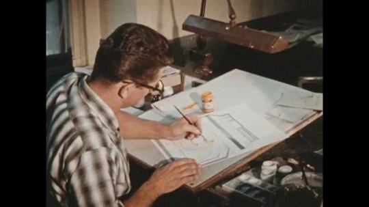 UNITED STATES 1960s: An artist ponders then statrts drawing a sun inside a drawing of an oven.