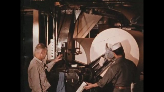 UNITED STATES 1960s: Newspaper, rolled through the mill, is cut and bound.