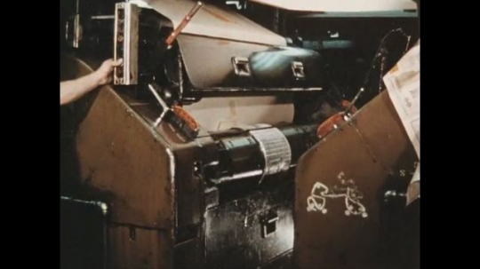 UNITED STATES 1960s: Newsprint is printed on as it goes through the press.