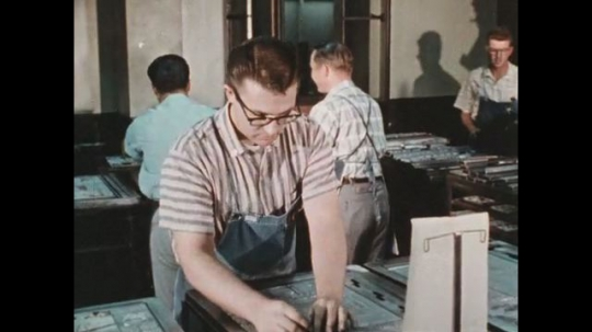 UNITED STATES 1960s: Men at work organize printing plates to be used for printing articles.