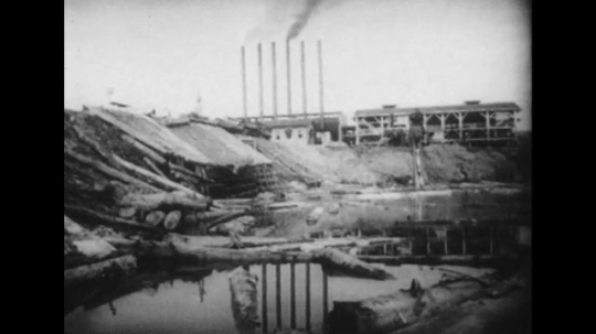 UNITED STATES 1940s: Montage of views of factories, steel mills.