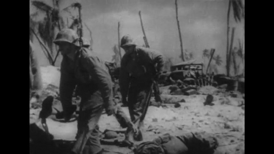 UNITED STATES 1940s: Soldiers carry wounded man on stretcher / Dead bodies on beach / Soldier uses flamethrower / Soldiers in trench.