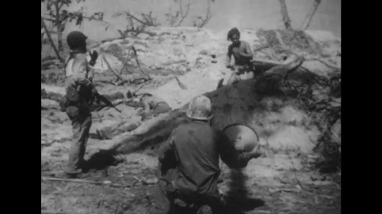 UNITED STATES 1940s: Soldier waves man out of hiding / Soldiers wave to man coming out of rubble / Man with white flag.