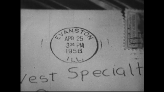 UNITED STATES 1950s : Postmarked letter and a clerk manually cancelling stamps.