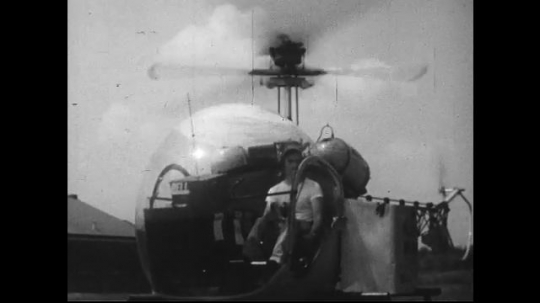 UNITED STATES 1950s : Pouches and sacks of mail and parcel are placed into a helicopter which delivers them to an airport to be sorted and placed into airplanes.
