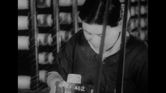 UNITED STATES 1940s: Scenes in Tokyo, woman at loom / Woman harvests grain / Man in factory / Elderly man on boat / Woman tends fire / Boy writes in classroom.