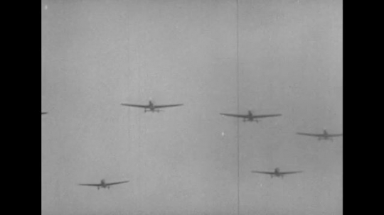 UNITED STATES 1940s: View of planes flying overhead / Pan of planes flying / Gunfire on water, planes fly over.