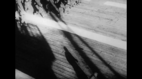 UNITED STATES 1940s: Japanese soldiers on carrier run to planes / Long shot of pilot in plane.