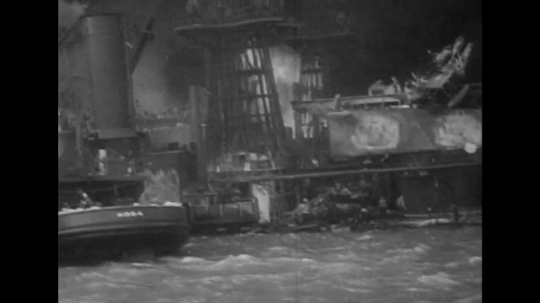 UNITED STATES 1940s: Views of destroyed battleships in Pearl Harbor.