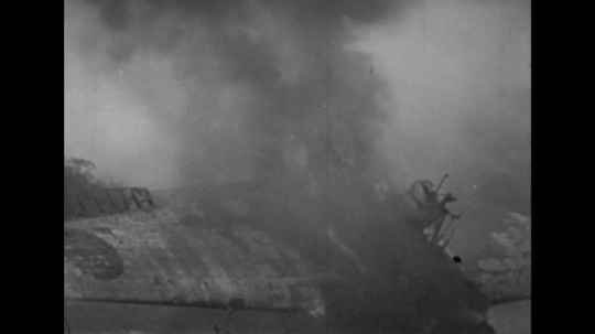 UNITED STATES 1940s: Views of destroyed airplanes at Pearl Harbor / Dead pilot in ocean.