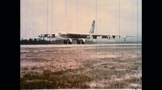UNITED STATES: 1970s: plane takes off from runway. Plane in sky