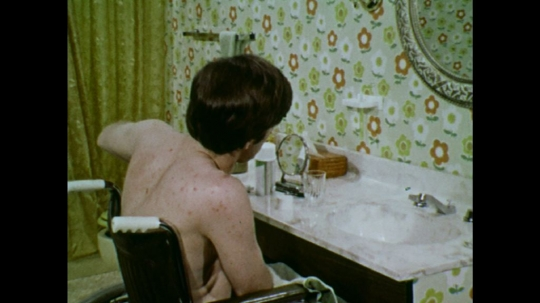 UNITED STATES: 1970s: man puts lid on deodorant. Man puts lid on toothpaste.