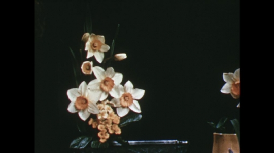 UNITED STATES: 1960s: finished flower arrangement on table