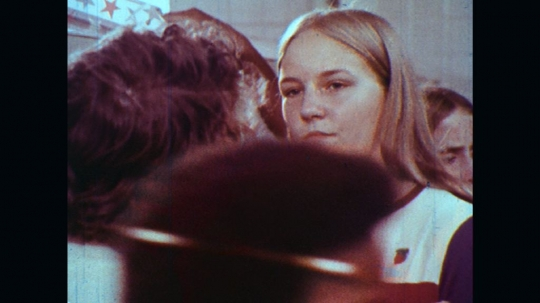 UNITED STATES: 1970s: boy talks to girl by school lockers. Students talk in corridor.