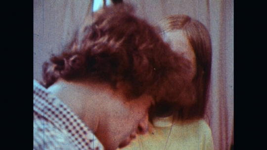 UNITED STATES: 1970s: boy gets annoyed. Man and lady come home