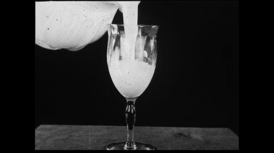 UNITED STATES 1930s: Close up of milk being poured.