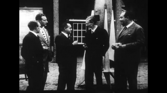 UNITED STATES 1930s: Members of the German Society of Space Travel converse.