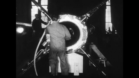 GERMANTY 1940s: Scientists build a rocket and weapons.
