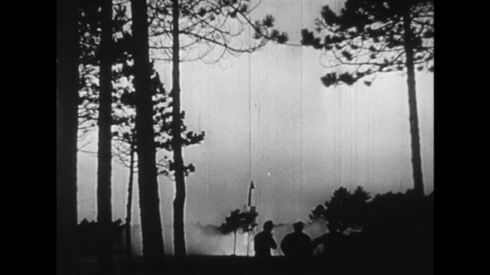 GERMANTY 1940s: A rocket successfully launches and opens fire in a town.