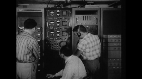 UNITED STATES 1950s: Men with radio equipment / Military general on phone.