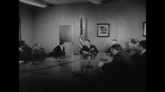 UNITED STATES 1950s: American generals and committees discuss putting a satellite into orbit.