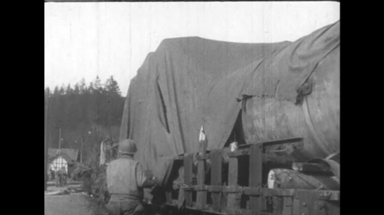 UNITED STATES 1950s: Weapons produced in Germany are loaded into trucks by soldiers.