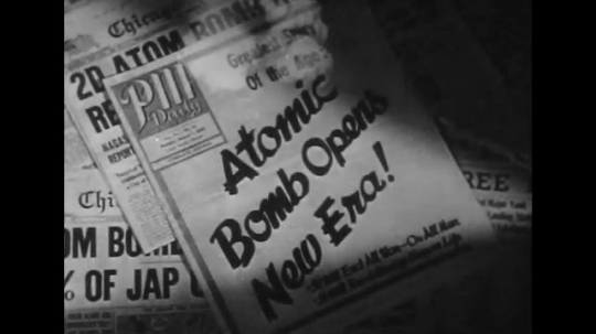 UNITED STATES 1940s: Newspapers headlines about atomic energy.