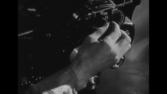 UNITED STATES 1940s: Hand on bomb sight / Bombardier in plane / Radar operator looks through viewer / Bombardier in plane.