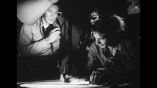 UNITED STATES 1940s: Operators with radar equipment, mapping location / Soldiers on ship.