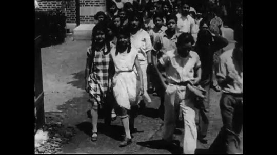 SANTA PAULA- CIRCA 1929: Middle grades and high school aged students exit a school and school yard.