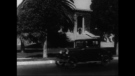 SANTA PAULA- CIRCA 1929: Long shot across a busy street of a government building