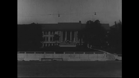 SANTA PAULA- CIRCA 1929: Extreme long shot of a school building with a large front stairset and pillars.  Students can be seen decending the steps.