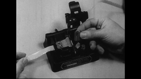 1940s-1960s : One end of a spliced film is moistened and cemented.