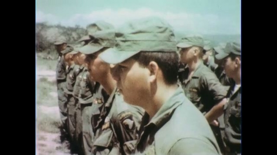 VIETNAM 1960s: Close up, soldiers at attention / Officer in front of soldiers / View of officer from behind soldiers.