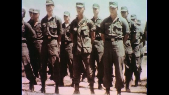 VIETNAM 1960s: Views of soldiers standing at ease / Officer speaking, soldiers in foreground.