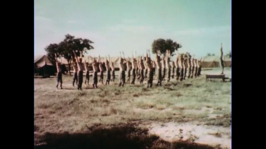 VIETNAM 1960s: Long shot, soldiers exercise in formation / View of soldiers from behind.