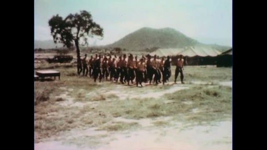 VIETNAM 1960s: Views of soldiers jogging in formation.